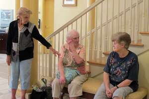 Helen Matulavage, left, with two other residents from the Callahan House senior housing in Seymour during the summer of 2011. Matulavage, whose daughter helped prompt state legislation on housing complex violence, died in 2017.