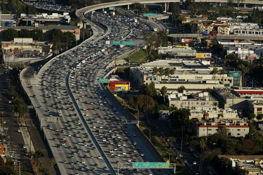 Vehicles in rush hour traffic approach the Interstate 405 freeway and 10 freeway interchange in this aerial photograph taken over Los Angeles in 2015. Photo: Bloomberg Photo By Patrick T. Fallon. / © 2017 Bloomberg Finance LP