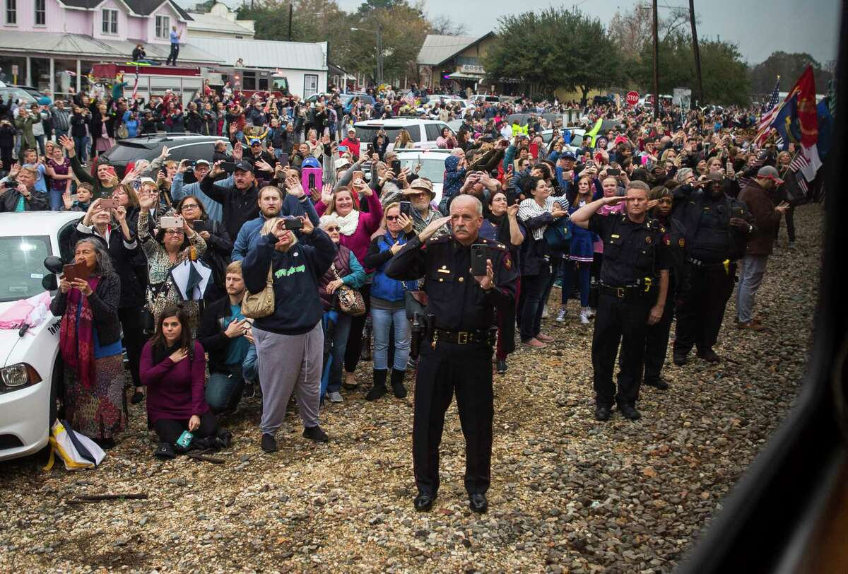 People watch as the train carrying former President George H.W. Bush passes through the Spring area on its way to College Station, Thursday, Dec. 6, 2018.