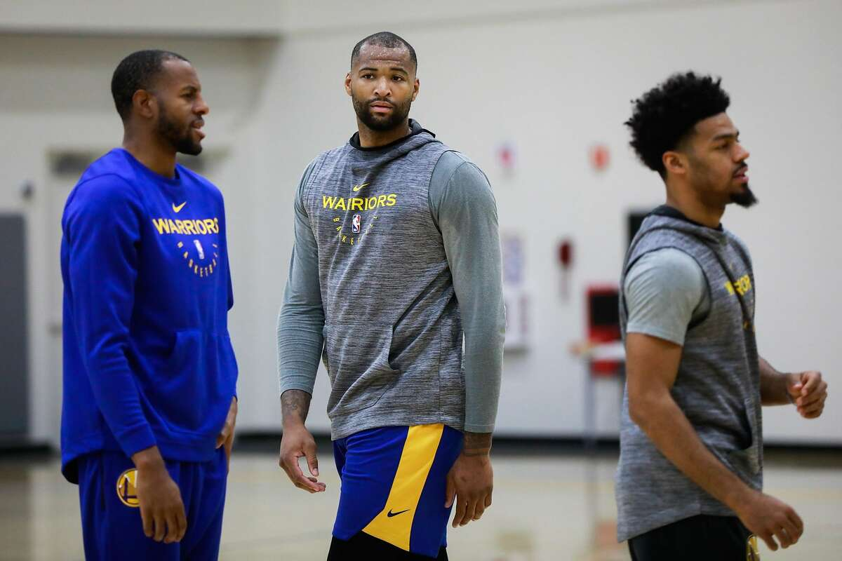 Warriors player DeMarcus Cousins (center) during Golden State Warriors' practice in Oakland, California, on Monday, Nov. 26, 2018.
