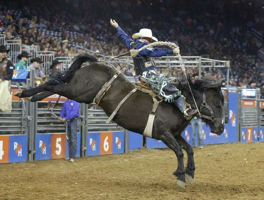 Mark-out  To avoid a disqualification, bronc riders keeps their heels ahead of the horse's shoulders on the first jump out of the chute. Pictured: Jacobs Crawley rides Mtn Climber at the Houston Rodeo. (Steve Gonzales/Houston Chronicle)