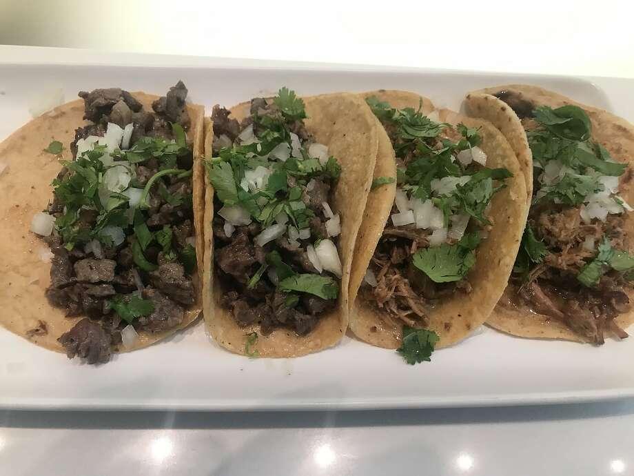 Carnitas and carne asada tacos at El Pipila. Photo: Justin Phillips