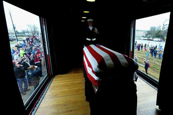 The casket of former President George H.W. Bush is attended by a Guard of Honor as it passes through Magnolia on its way to College Station for burial, Thursday, Dec. 6, 2018.