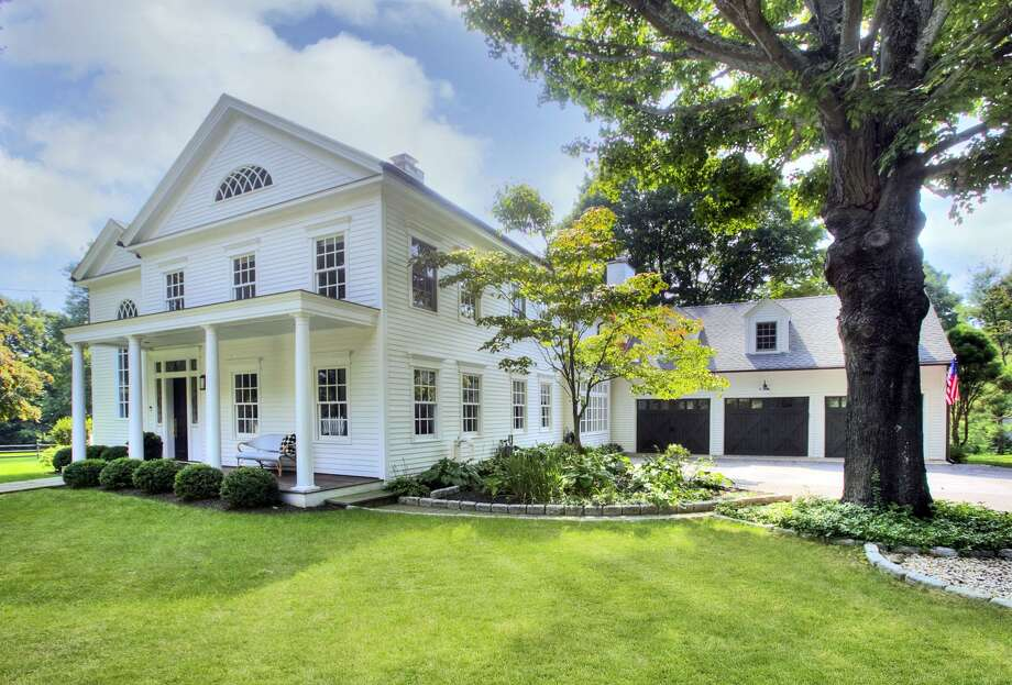 The eye-catching, 5,415-square foot Colonial at 2493 Redding Road in Fairfield is roughly 200 years old, having been built in 1817. As such, it has many antique details, including its arched doorways, antique moldings and stone fireplaces. But it also has modern functionality, and wide-open spaces. The home also has such features as a windowed, three-season porch, a gazebo, pool and a barn, that dates to the 1980s but was built with reclaimed antique wood. Photo: Contributed Photo / Contributed Photo / Connecticut Post Contributed
