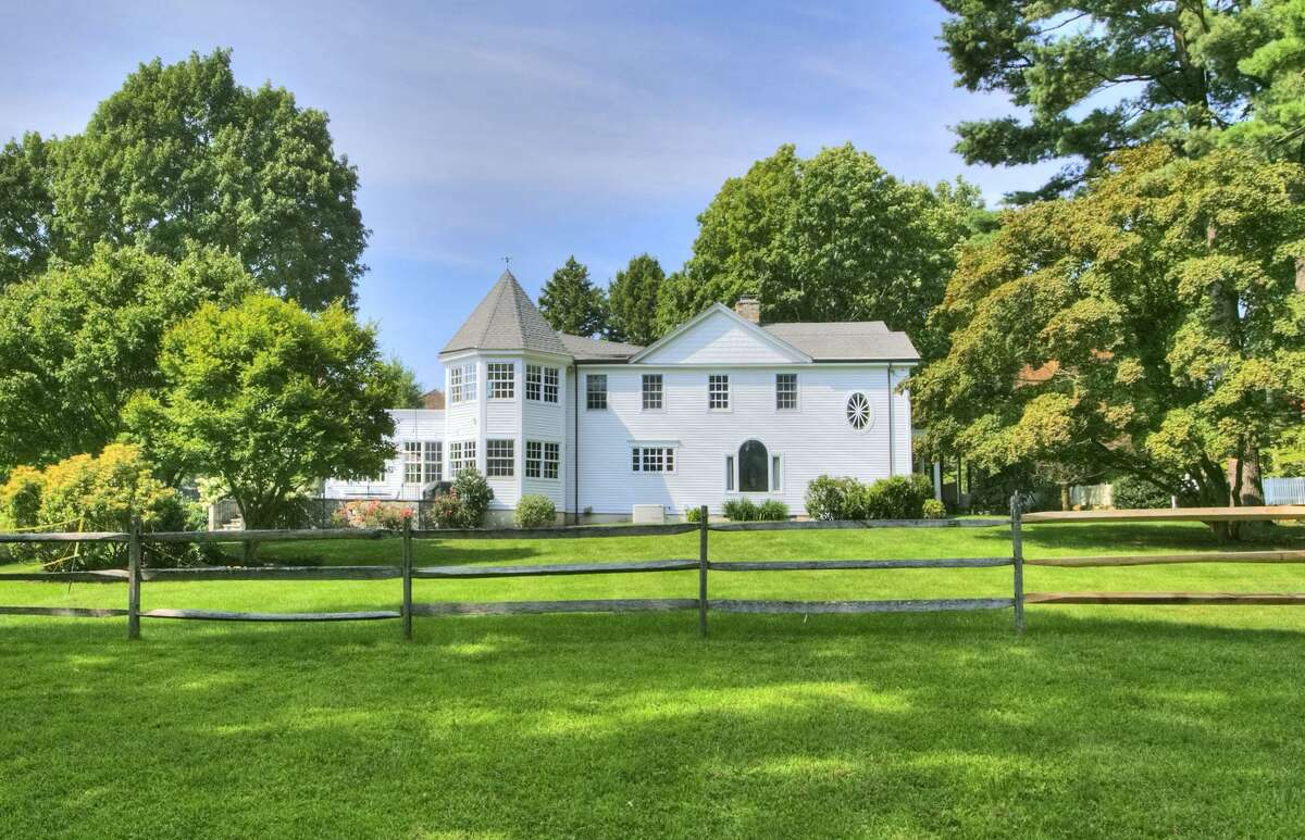 The eye-catching, 5,415-square foot Colonial at 2493 Redding Road in Fairfield is roughly 200 years old, having been built in 1817. As such, it has many antique details, including its arched doorways, antique moldings and stone fireplaces. But it also has modern functionality, and wide-open spaces. The home also has such features as a windowed, three-season porch, a gazebo, pool and a barn, that dates to the 1980s but was built with reclaimed antique wood.