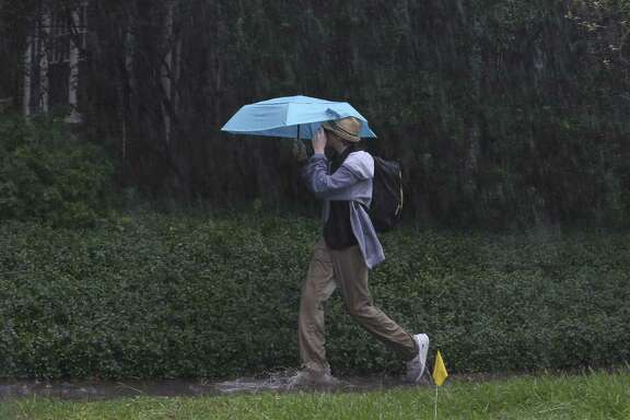 Northwest Harris County school districts have cancelled after-school activities for Dec. 7 and Dec. 8. Pictured here: A Lanier Middle School student walks home after school in the heavy rain on Wednesday, Oct. 31, 2018, in Houston.