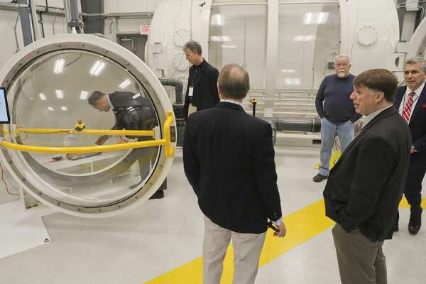 Participants at the High Speed. Aerospace Transportation Workshop watch a demonstration of the high pressure altitude chamber formerly used by Orbital Outfitters 12/06/18. Tim Fischer/Reporter-Telegram