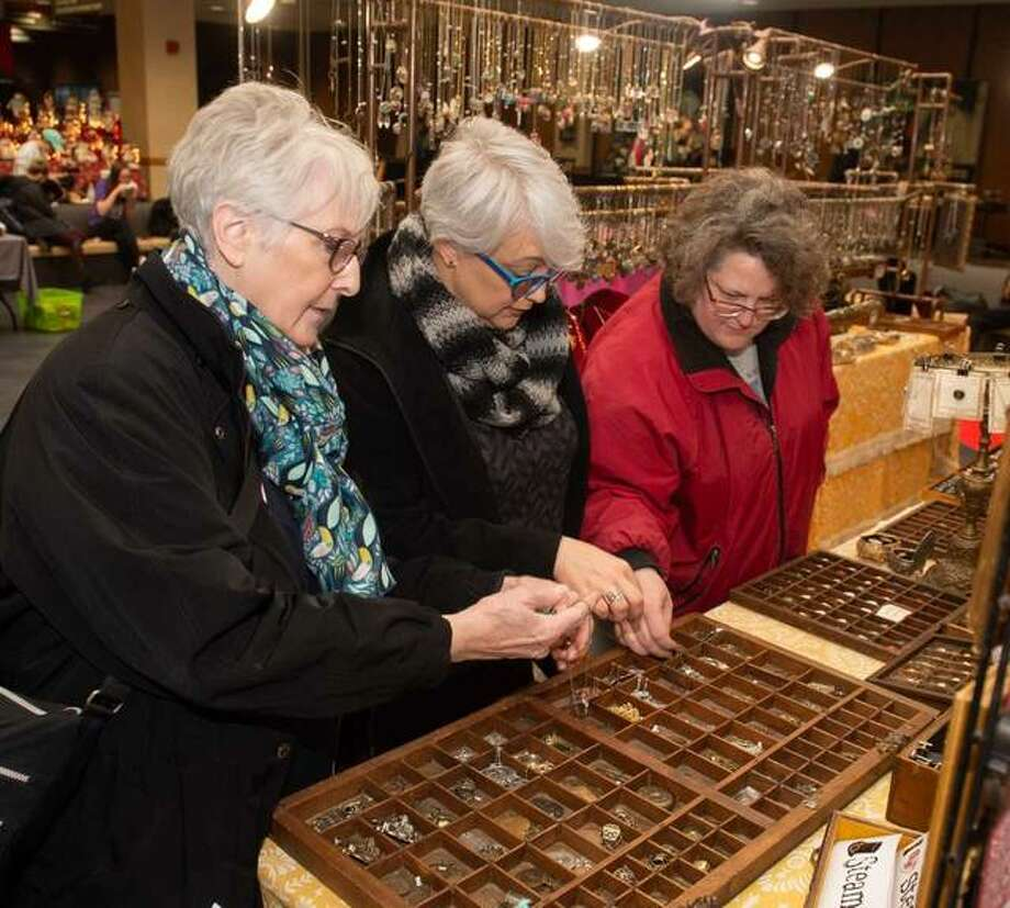 One family shops together during SIUE's Annual Holiday Arts and Crafts Fair. Shown from L-R are mother and SIUE alumna Janet Smith, of Edwardsville, who graduated with a bachelor's in nursing; daughter Laura Jeziorski, of Glen Carbon; and daughter and SIUE alumna Jennifer Moran, of Glen Carbon, who graduated with a bachelor's in nursing. Photo: For The Intelligencer