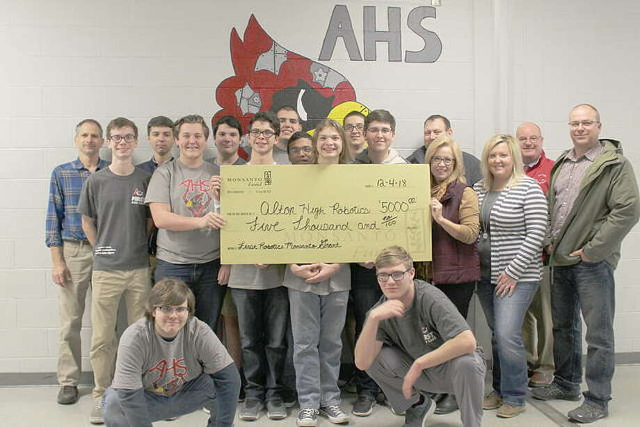 The Alton High School Robotics Team with Monsanto representatives after the company awarded the club with a $5,000 grant to support their activities and encourage local students who participate in the program. Photo: For The Telegraph
