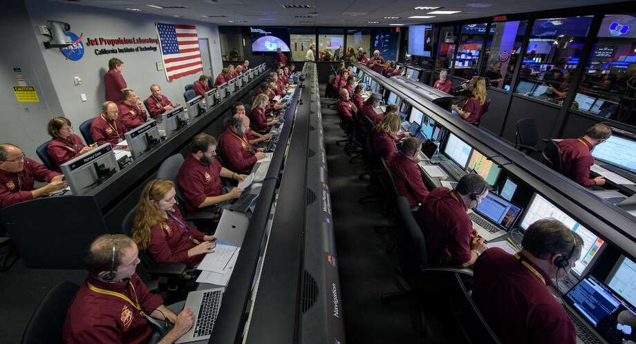 """Mars InSight team members monitor the status of the lander prior to it touching down on Mars, Monday, Nov. 26, 2018 inside the Mission Support Area at NASA's Jet Propulsion Laboratory in Pasadena, California. InSight, short for Interior Exploration using Seismic Investigations, Geodesy and Heat Transport, is a Mars lander designed to study the """"inner space"""" of Mars: its crust, mantle, and core. Photo: NASA/Bill Ingalls / Contributed Photo / Connecticut Post Contributed"""