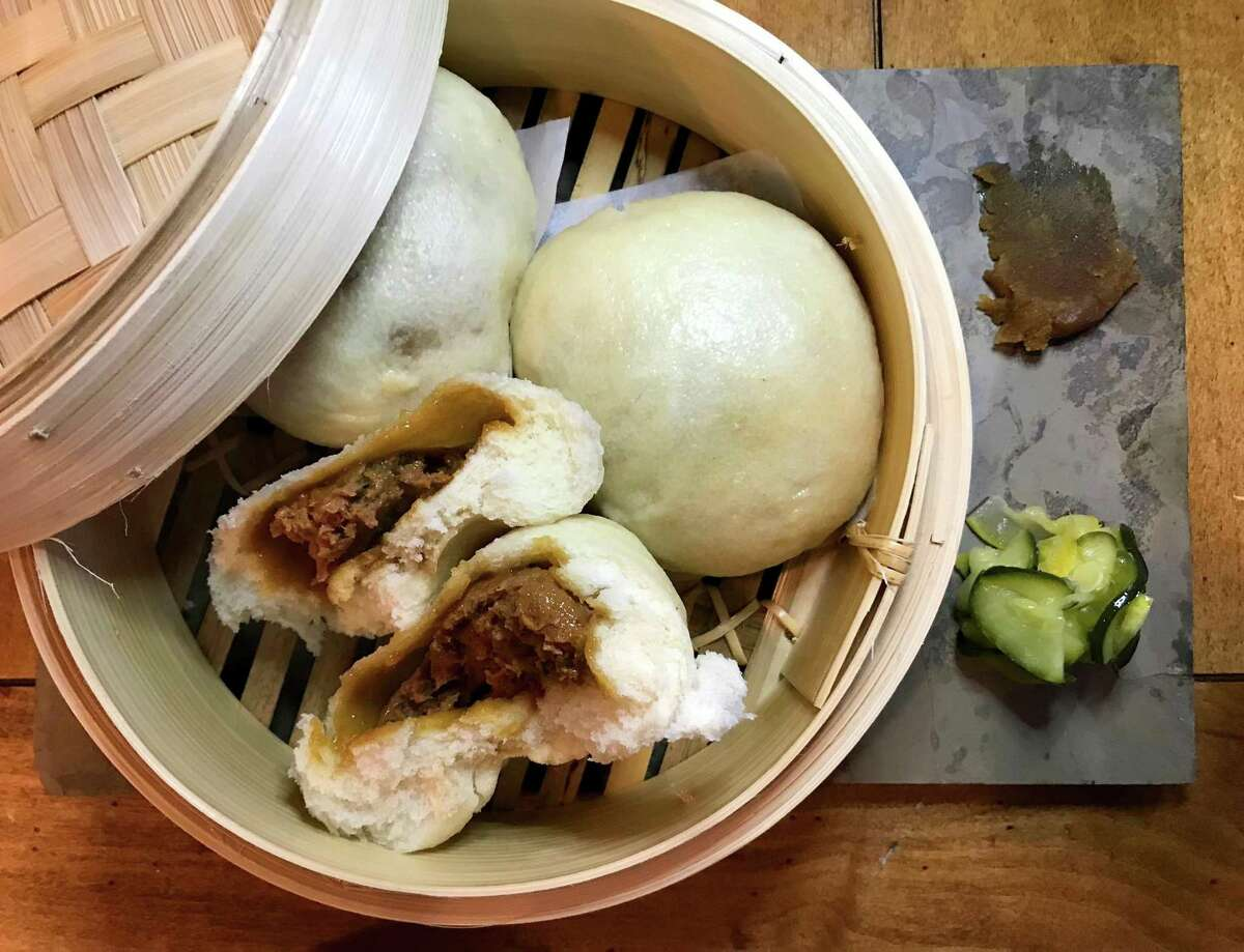 Steamed buns at Kuriya are generously filled with a flavorful mixture of pork, ginger and green onion.