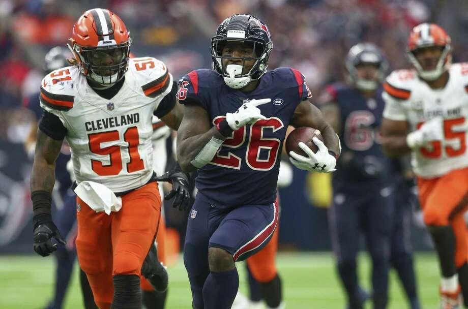 Lamar Miller (26) rushes the ball against the Cleveland Browns at NRG Stadium Sunday, Dec. 2, 2018. Photo: Godofredo A. Vasquez, Houston Chronicle / Staff Photographer / 2018 Houston Chronicle