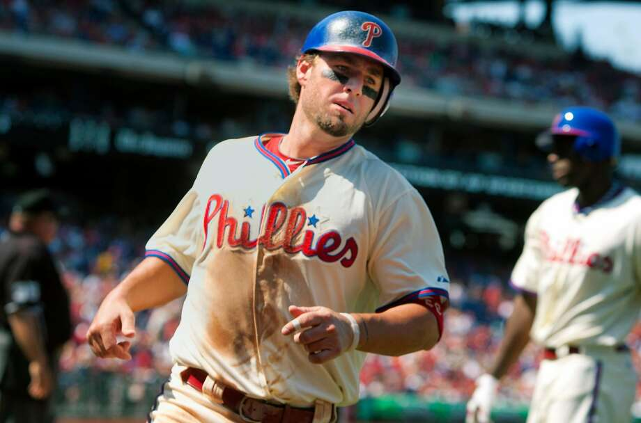Kevin Frandsen scores a run for the Phillies in 2012. He will call 81 games for the team on radio in 2019. Photo: Ed Hille / AP