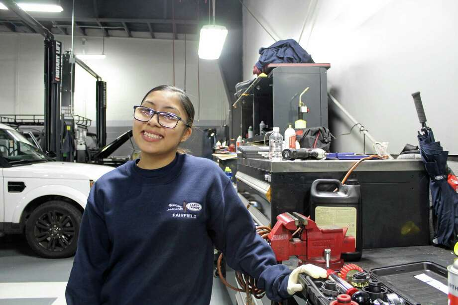 Prisila Barroso is the first female technician at Jaguar Land Rover Fairfield. Photo: Humberto J. Rocha / Hearst Connecticut Media / New Canaan News