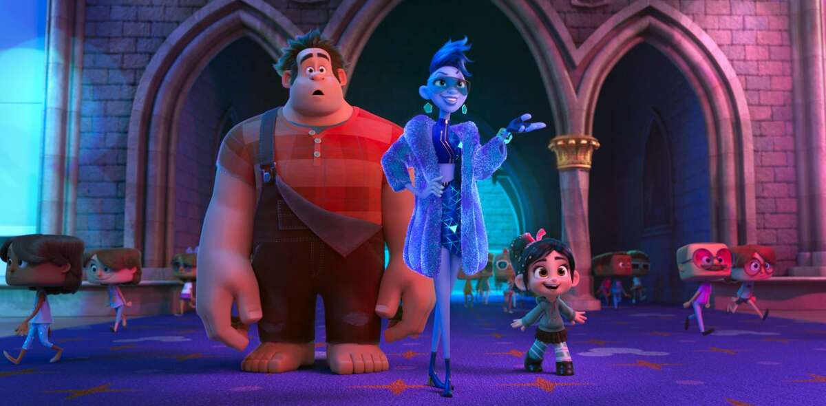 This image released by Disney shows characters, from left, Ralph, voiced by John C. Reilly; Yess, voiced by Taraji P. Henson and Vanellope von Schweetz, voiced by Sarah Silverman in a scene from