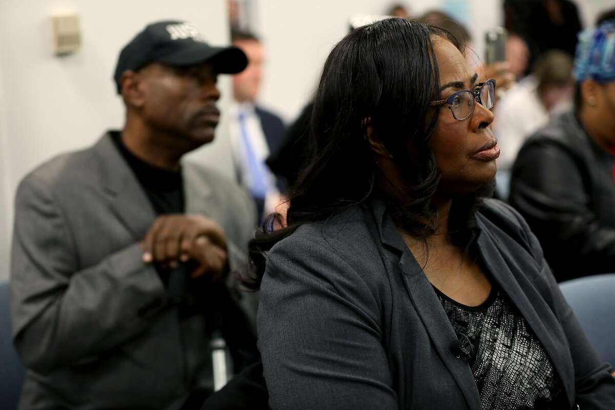 Cephus Johnson, uncle of the late Oscar Grant III, and Wanda Johnson, Grant's mother, listen to BART board members speak during a meeting at the San Francisco Bay Area Rapid Transit District Board of Directors in Oakland on December 6, 2018.