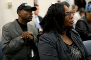Cephus Johnson, uncle of the late Oscar Grant III, and Wanda Johnson, Grant's mother, listen to BART board members speak during a meeting at the San Francisco Bay Area Rapid Transit District Board of Directors in Oakland, Calif., on Thursday, December 6, 2018. A couple of BART board members, including Debora Allen of Danville, are upset about the planned Oscar Grant mural at the Fruitvale BART station and they aired their differences at the meeting Thursday morning.