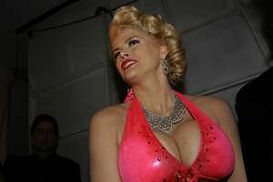 NEW YORK - FEBRUARY 12:  Anna Nicole Smith poses backstage at the Heatherette fashion show during Olympus Fashion Week at Bryant Park February 12, 2004 in New York City.  (Photo by Bryan Bedder/Getty Images)