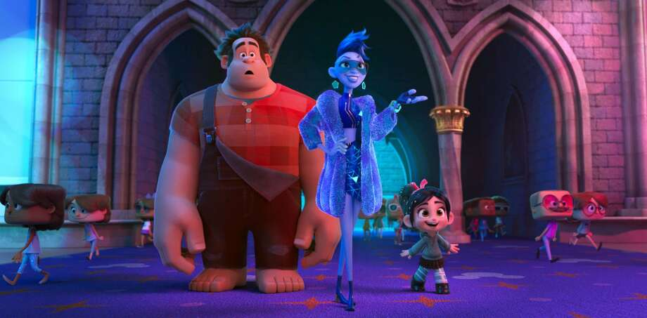 "This image released by Disney shows characters, from left, Ralph, voiced by John C. Reilly; Yess, voiced by Taraji P. Henson and Vanellope von Schweetz, voiced by Sarah Silverman in a scene from ""Ralph Breaks the Internet."" Thanksgiving leftovers led the box office, as Disney's ""Ralph Breaks the Internet"" grossed $25.8 million to repeat as the No. 1 film in U.S. and Canadian theaters. The ""Wreck-It Ralph"" sequel dropped steeply after nearly setting a Thanksgiving record last weekend. But with only one new film in wide release, nothing came close to ""Ralph Breaks the Internet"" in the typically quiet post-Thanksgiving weekend. (Disney via AP, File) Photo: Disney Via Associated Press / ©2018 Disney. All Rights Reserved."