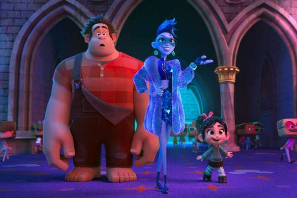 """This image released by Disney shows characters, from left, Ralph, voiced by John C. Reilly; Yess, voiced by Taraji P. Henson and Vanellope von Schweetz, voiced by Sarah Silverman in a scene from """"Ralph Breaks the Internet."""" Thanksgiving leftovers led the box office, as Disney's """"Ralph Breaks the Internet"""" grossed $25.8 million to repeat as the No. 1 film in U.S. and Canadian theaters. The """"Wreck-It Ralph"""" sequel dropped steeply after nearly setting a Thanksgiving record last weekend. But with only one new film in wide release, nothing came close to """"Ralph Breaks the Internet"""" in the typically quiet post-Thanksgiving weekend. (Disney via AP, File)"""