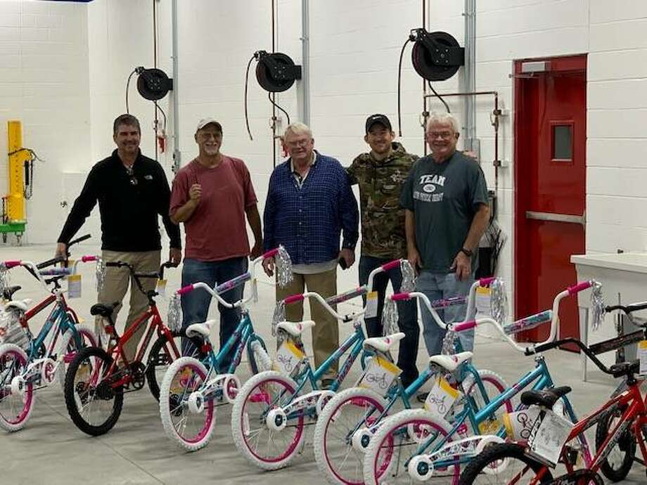 Pictured left to right is Steve Schwegel, owner of Alton Physical Therapy; Mike Turk, a Freer family friend; Ed Schwegel; J.T. File, an Alton Physical Therapy employee; and, John Schwegel. Not pictured is John Hamilton. These gentlemen took nearly two hours assembling the bicycles that are part of donations for Community Christmas. Photo: For The Intelligencer