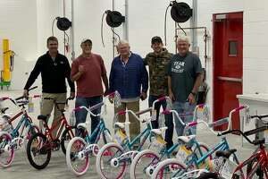 Pictured left to right is Steve Schwegel, owner of Alton Physical Therapy; Mike Turk, a Freer family friend; Ed Schwegel; J.T. File, an Alton Physical Therapy employee; and, John Schwegel. Not pictured is John Hamilton. These gentlemen took nearly two hours assembling the bicycles that are part of donations for Community Christmas.