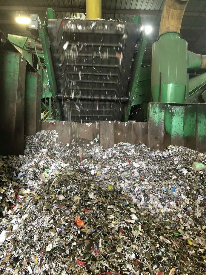 Recycled glass is processed at a local recycling facility. Small items gets mixed with the glass, contaminating it and reducing its market value. Photo: Contributed Photo / Contributed Photo / The News-Times Contributed
