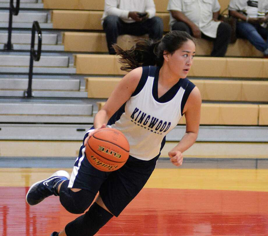 Kingwood's Anna Chong looks to pass during the Klein Forest and Kingwood girls basketball scrimmage at Oak Ridge High School. Photograph by David Hopper Photo: Z-David Hopper