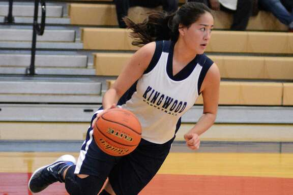 Kingwood's Anna Chong looks to pass during the Klein Forest and Kingwood girls basketball scrimmage at Oak Ridge High School. Photograph by David Hopper