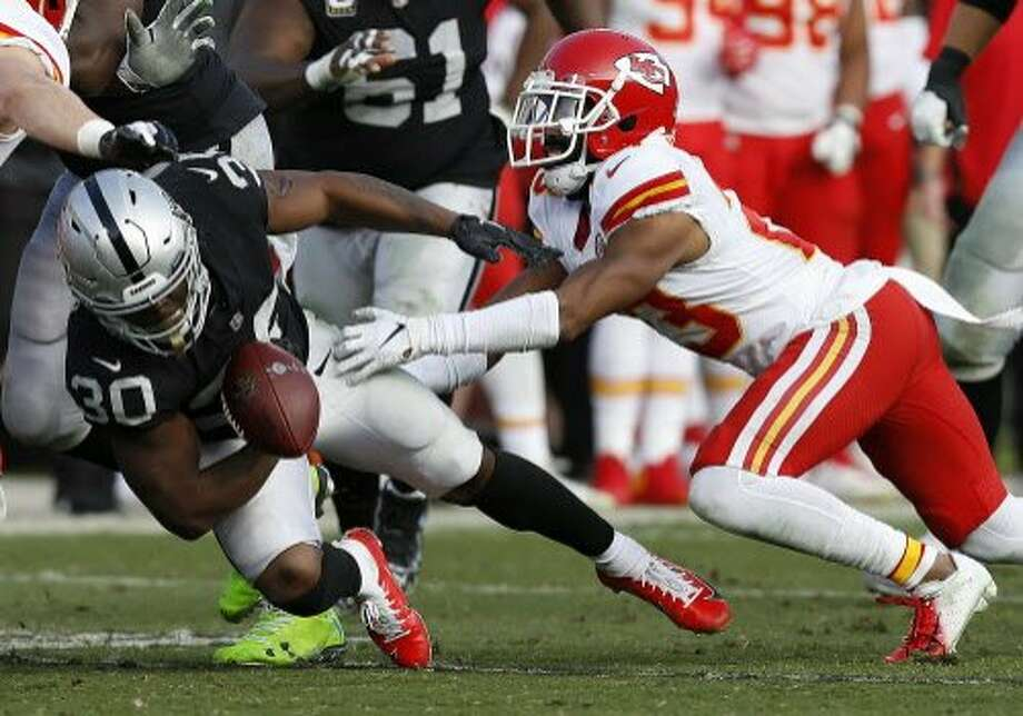 Oakland Raiders running back Jalen Richard (30) fumbles in front of Kansas City Chiefs cornerback Kendall Fuller during the second half. The Chiefs recovered the ball. Photo: D. Ross Cameron / Associated Press