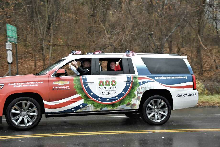 Specially wrapped Wreaths Across America vehicle rolling through Branford as part of America's longest veterans parade last year. Photo: Bill O'Brien / For Hearst Connecticut Media / New Haven Register freelance