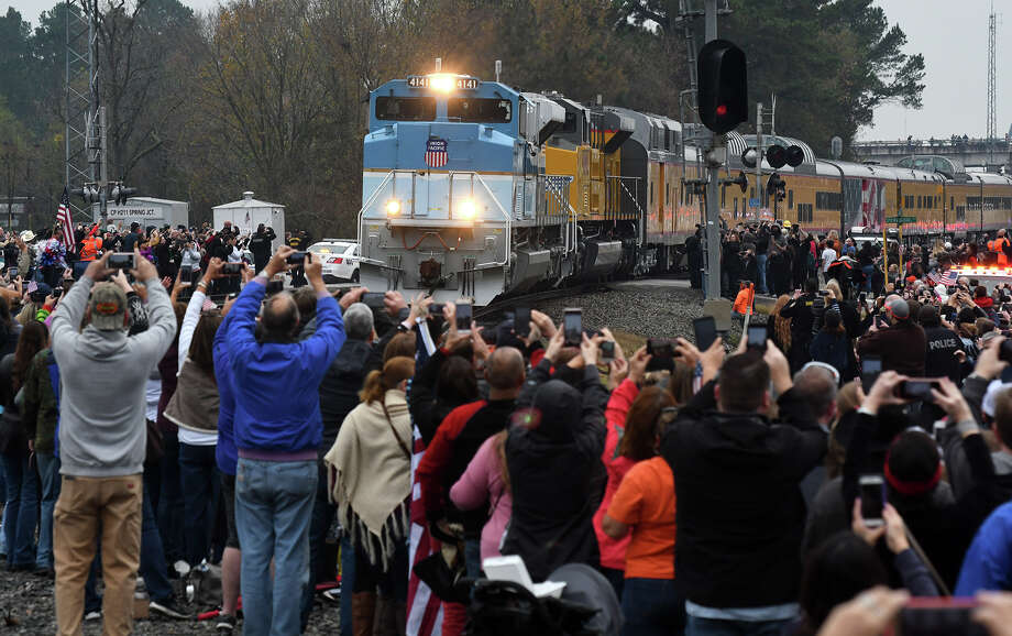 Union Pacific Locomotive No. 4141, carrying the body of former president George H.W. Bush, aprroaches the intersection of Main St. and West Hardy Road in Old Town Spring as people line both sides of the track to catch a glimpse of the train while on it's way to College Station for President Bush's burial on the site of his presidential library on Dec. 7, 2018. Photo: Jerry Baker