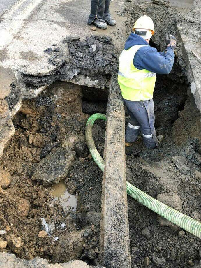 South Norwalk Electric and Water said Wednesday that there would be an emergency water shutdown on Thursday from 9 a.m. to 3 p.m. to fix the water main. The break happened in the Rowayton section of Norwalk and was expected to leave houses between 195 and 215 Rowayton Avenue and houses between 1 and 23 Cudlipp St. without water while repairs were underway. Photo: Contributed Photo / South Norwalk Electric And Water / Contributed Photo / Connecticut Post Contributed