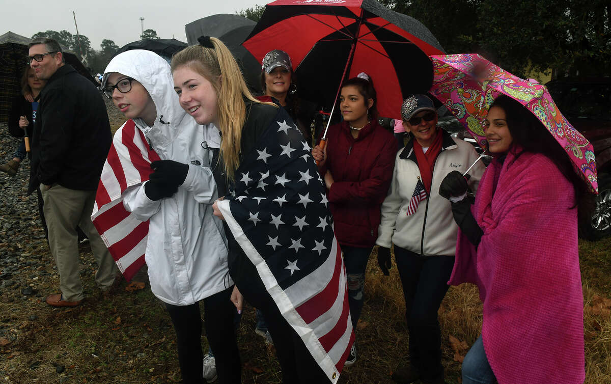 Myranda Uber, 15, left, a freshman at Oak Ridge High School, and her sister Charli, 16, an ORHS junior, wait near the intersection of Main St. and West Hardy Road in Old Town Spring for the arrival of Union Pacific Locomotive No. 4141 carrying the body of former president George H.W. Bush through Old Town Spring on it's way to College Station for burial on the site of Bush's presidential library on Dec. 7, 2018.