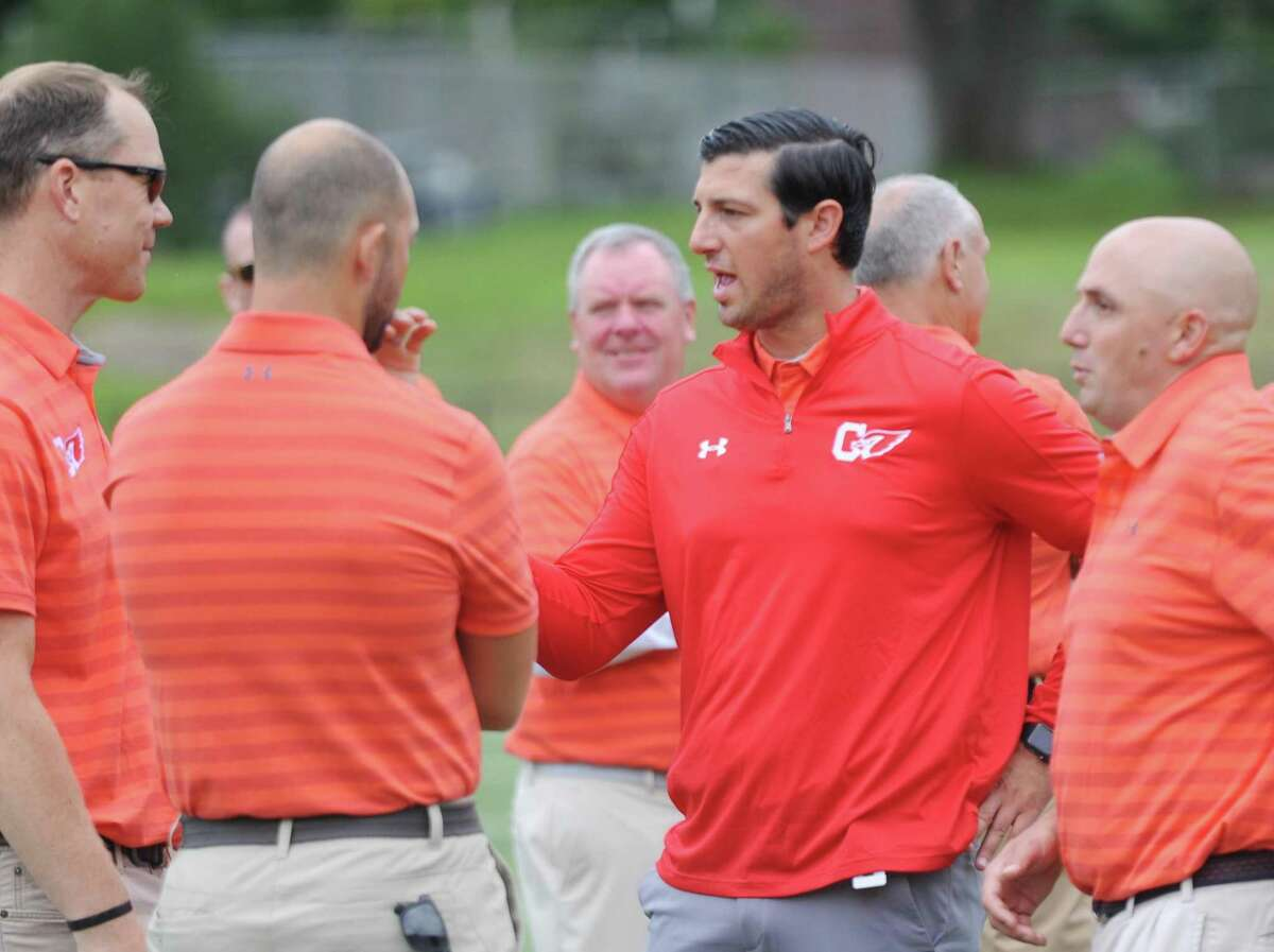 Greenwich coach John Marinelli talks with his assistants on media day at Greenwich High on Aug. 19.