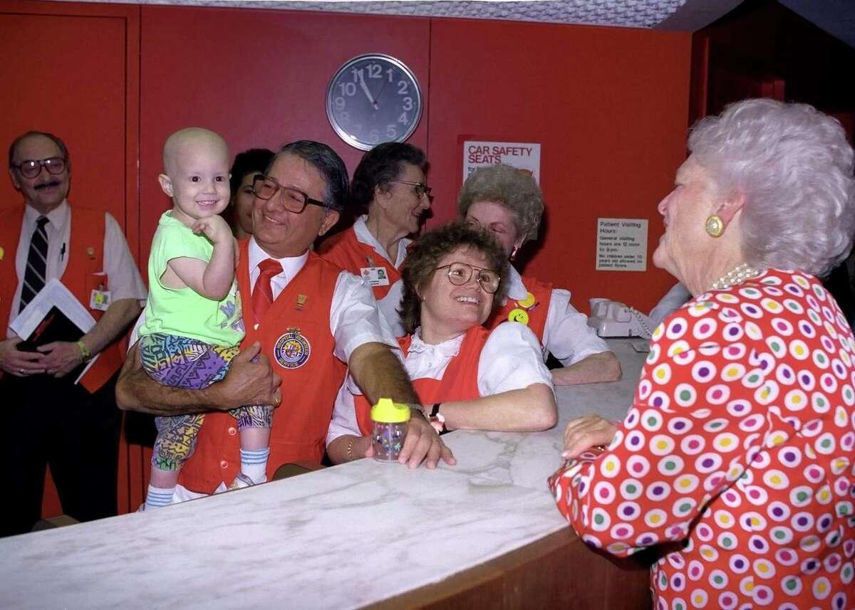 Gene Macy with Barbara Bush at Texas Children's Hospital in 1991.
