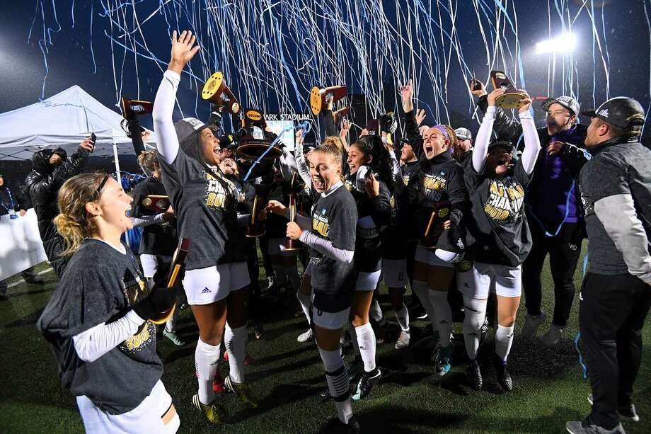 The University of Bridgeport women's soccer team celebrates the Division II national title Saturday Photo: University Of Bridgeport