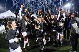 The University of Bridgeport women's soccer team celebrates the Division II national title Saturday