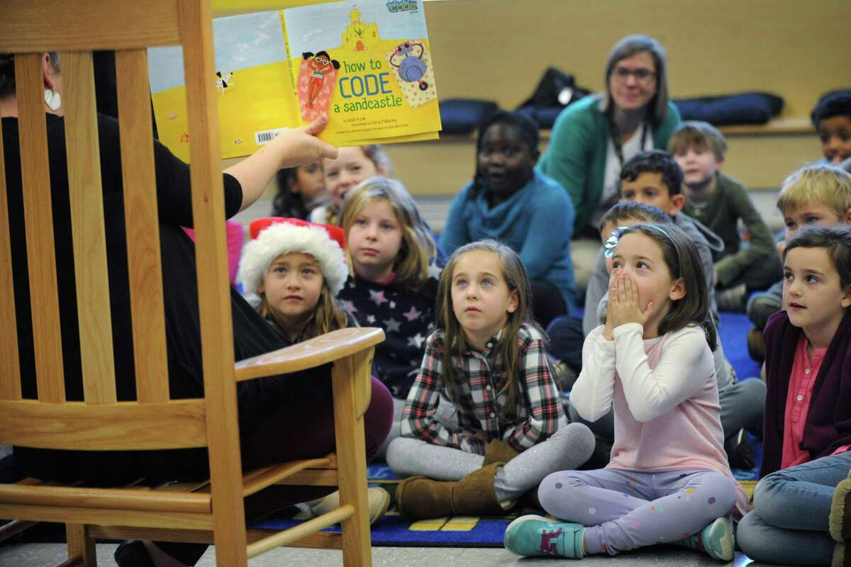 """First graders in Maureen Hitchcock class listen to story about coding from Library Media Specialist Erin D'Elia as part of Rowayton Elementary School's ?""""Hour of Code?"""" Thursday, December 6, 2018, in Norwalk, Conn."""
