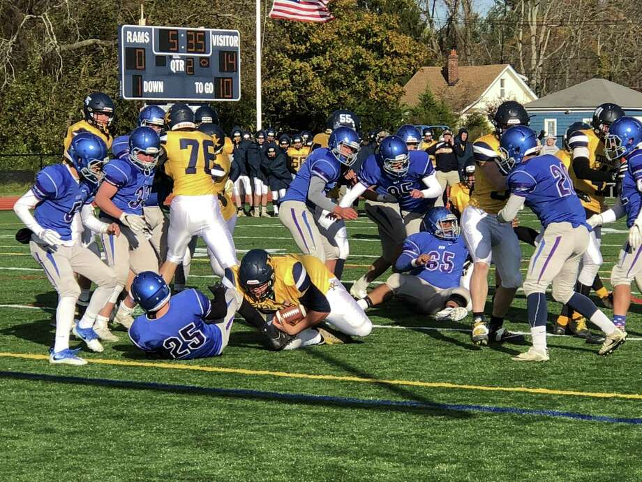 Haddam-Killingworth's Trey Callendar rumbles in from the 1-yard line for a touchdown against Old Saybrook/Westbrook. Photo: Paul Augeri / For Hearst Connecticut Media