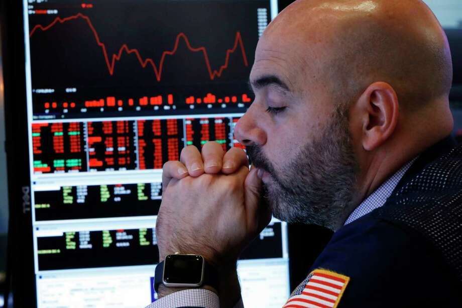 Trader Fred DeMarco works on the floor of the New York Stock Exchange, Thursday, Dec. 6, 2018. U.S. stocks tumbled in early trading Thursday following a sell-off in overseas markets. (AP Photo/Richard Drew) Photo: Richard Drew / Copyright 2018 The Associated Press. All rights reserved