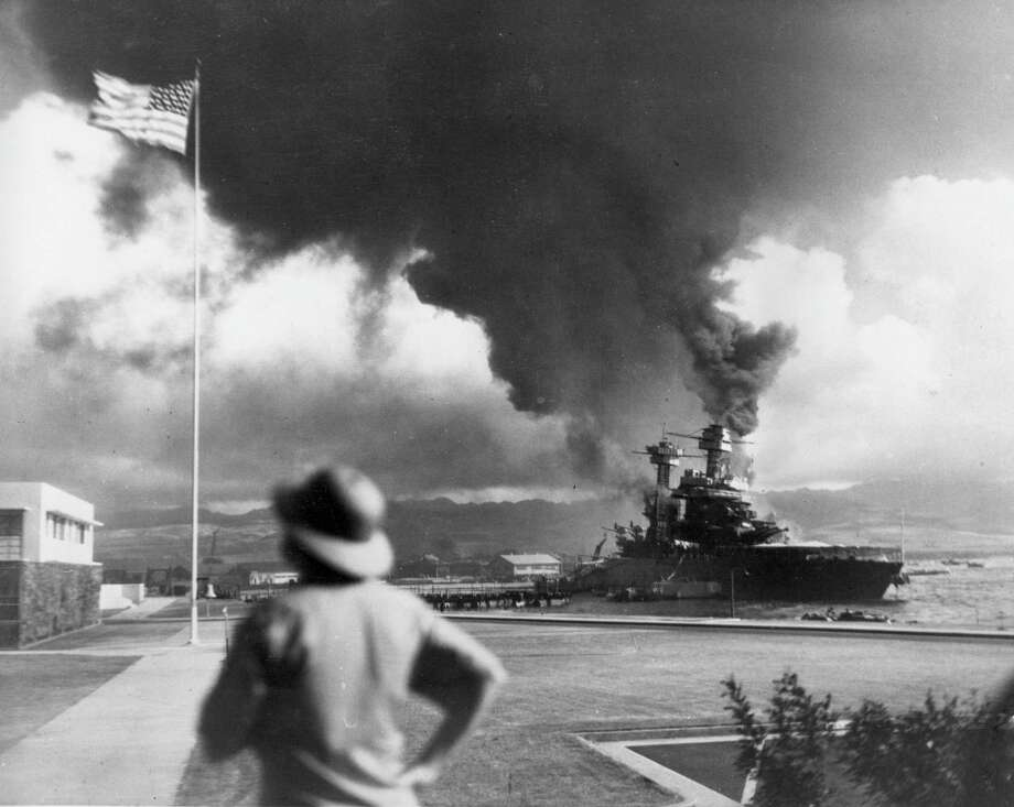 American ships burn during the Japanese attack on Pearl Harbor, Hawaii, in this Dec. 7, 1941 file photo. (AP Photo/File) Photo: Associated Press File Photos / AP