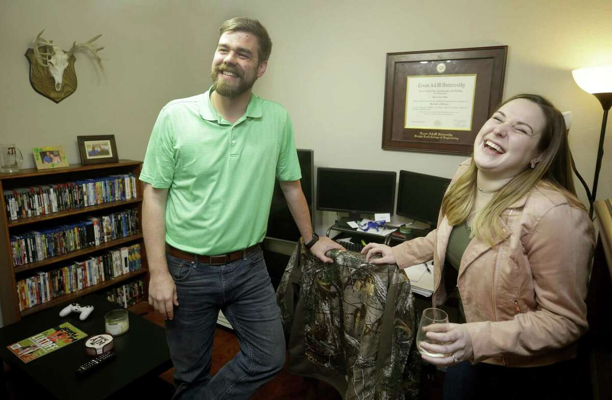 Mason Hyde and his wife, Kelly Hyde, who formed a friendship while attending Texas A&M, laugh as they talk about how they started dating shown at their home Monday, Nov. 26, 2018, in Spring. Millennials are getting divorced at a way lower rate than previous generations, and according to sociologists, this means that divorce will continue to trend downward in recent years.