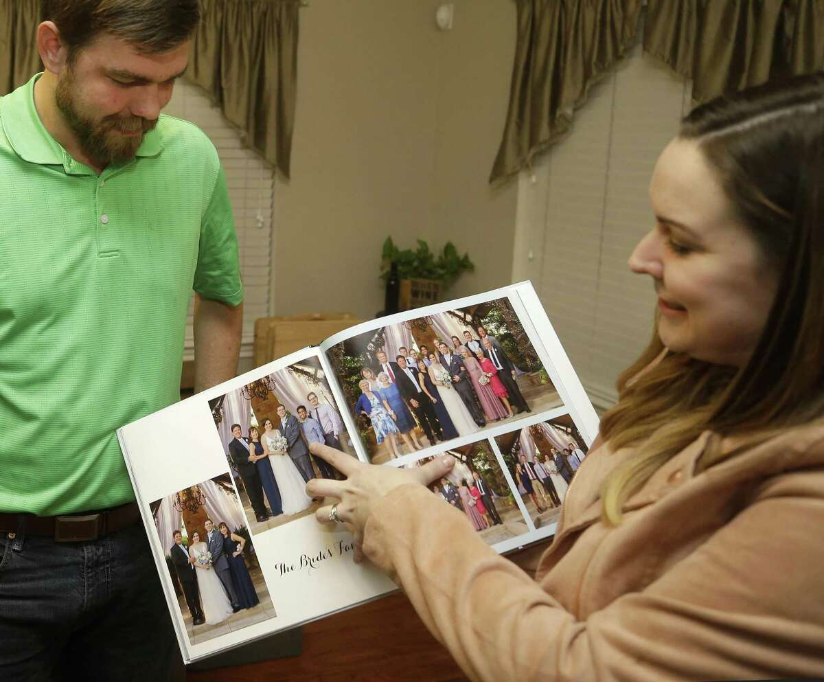 Mason Hyde and his wife, Kelly Hyde, talk about their 2016 wedding shown at their home Monday, Nov. 26, 2018, in Spring. They met while attending Texas A&M. Millennials are getting divorced at a way lower rate than previous generations, and according to sociologists, this means that divorce will continue to trend downward in recent years.