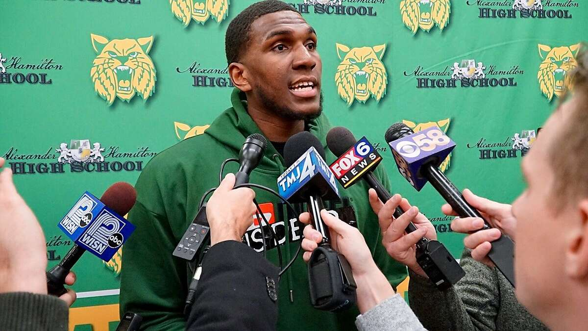 Warriors center Kevon Looney speaks to reporters after having his high school jersey number retired in Milwaukee.