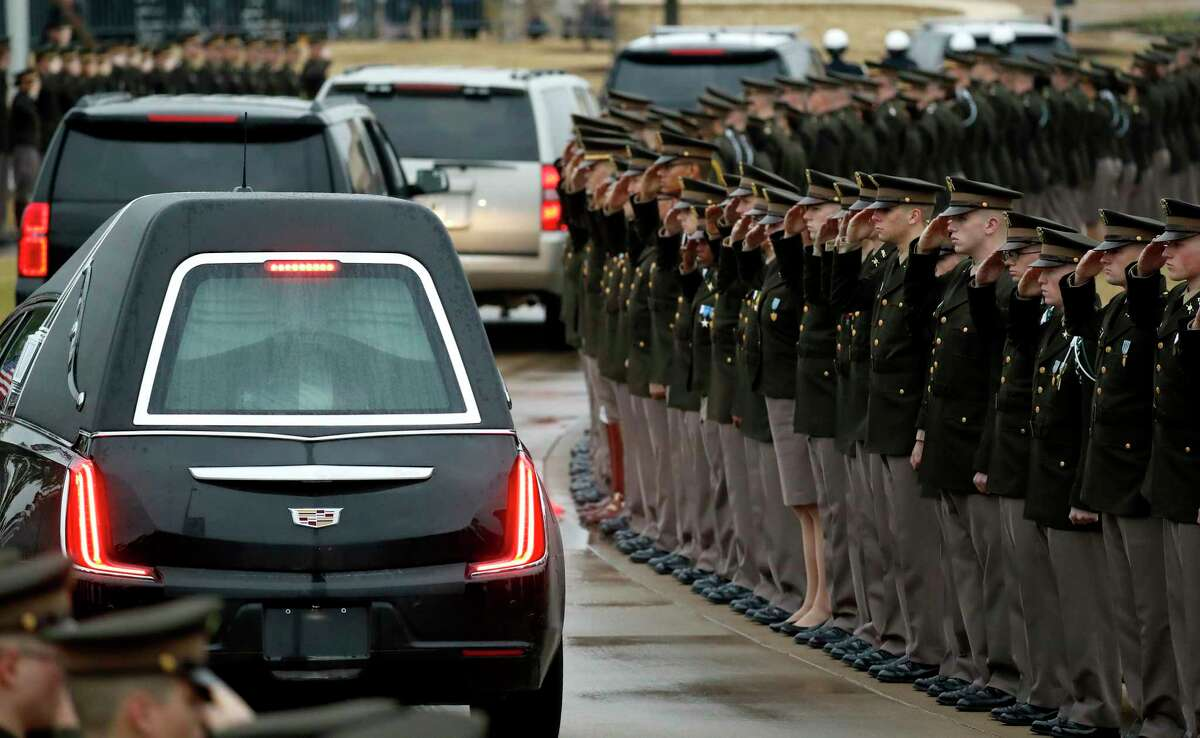 Members of the Texas A&M University Corps of Cadets salute the motorcade of former President George H.W. Bush during his arrival and interment at the George Bush Presidential Library and Museum, Thursday, Dec. 6, 2018, in College Station.
