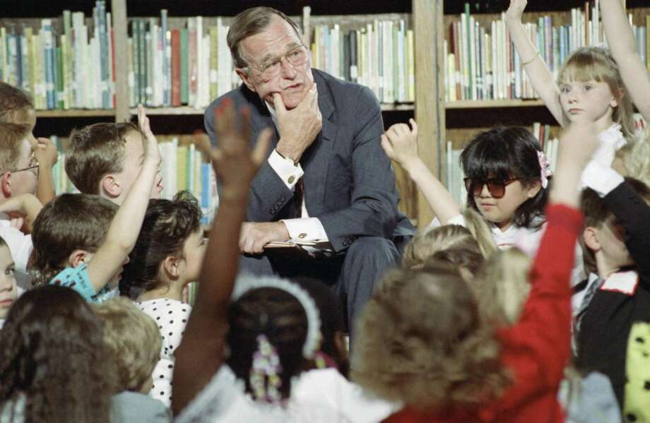 U.S. President George H. Bush waits to answer a question from a student in Chicago in 1990. This week of mourning offers an opportunity to put aside our contempt and come together as a nation. Photo: Associated Press File Photo / AP1990