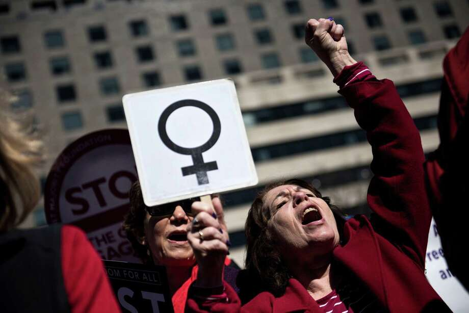 Activists last year march in Washington for International Woman's Day. The #MeToo movement is sparking such fear that women's progress in the workplace is at risk. Photo: Brendan Smialowski /Getty Images / AFP or licensors