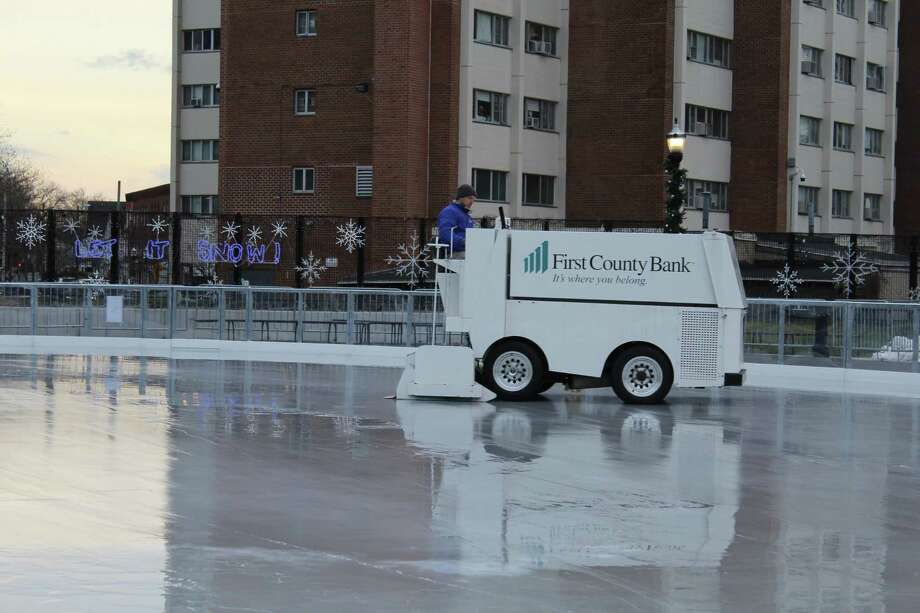 With hours before opening for the season, the new rink in Mill River Park got a final sheen thanks to an ice resurfarcer on Thursday, Dec. 6, 2018. Photo: Barry Lytton / Hearst Connecticut Media / Stamford Advocate