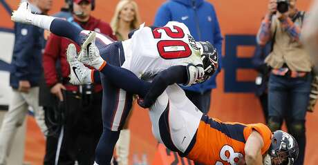 Houston Texans strong safety Justin Reid (20) brings down Denver Broncos tight end Jeff Heuerman (82) during the second quarter of an NFL football game at Broncos Stadium at Mile High on Sunday, Nov. 4, 2018, in Denver.